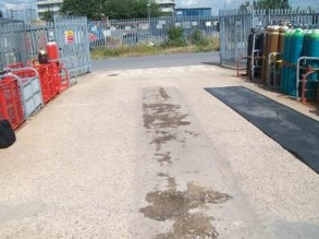 Impact damaged concrete from unloading gas cylinders